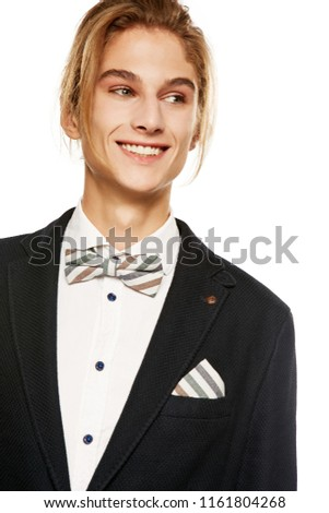 c9905f2ca0 A handsome young man in a black suit jacket and button up shirt,  accessorized with