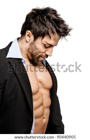 A handsome young muscular sports man in business suit