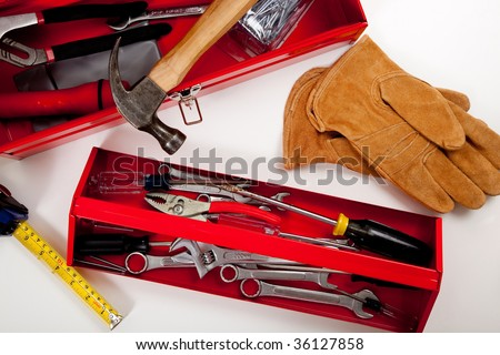 A handyman's tool box with assorted tools including hammer, measuring tape, pliers etc.