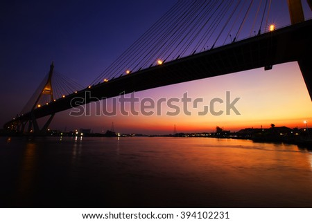 a hanging bridge at night in thailand #394102231