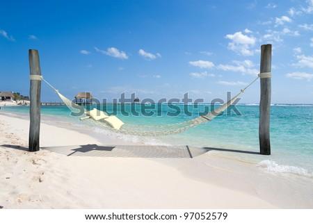 A hanging hammock, on a beach resort