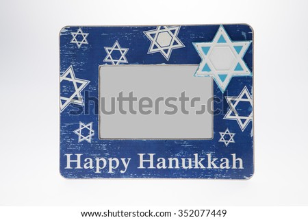 A Hanukkah picture frame against a white background