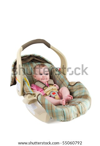 A happy baby girl sitting in a car seat isolated on a white background