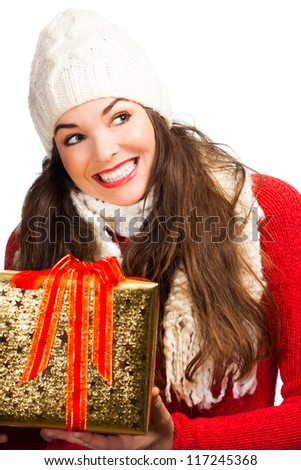 A happy beautiful smiling woman holding a beautifully wrapped Christmas gift. Isolated on white.