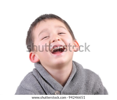A happy boy is laughing on white