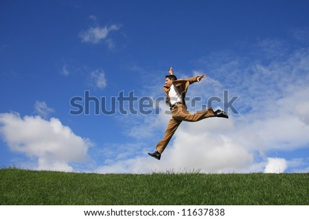 A happy business man jumping to the success