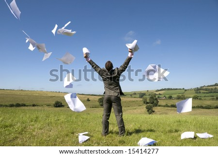 A happy businessman lets go of this paperwork!
