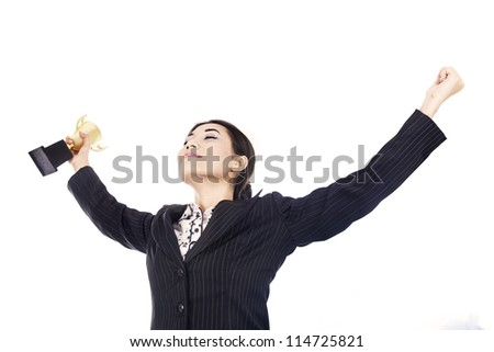 A happy businesswoman celebrating her winning holding the trophy isolated over white