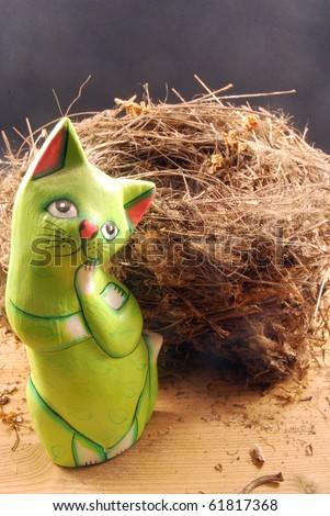 A happy cat near a bird's nest empty