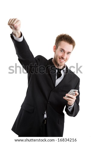 A happy caucasian businessman raising his fist after receiving a text message - stock photo