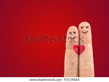 Photo of A happy couple in love with painted smiley