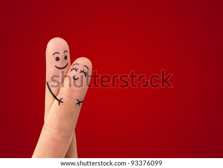 Shutterstock A happy couple in love with painted smiley and hugging