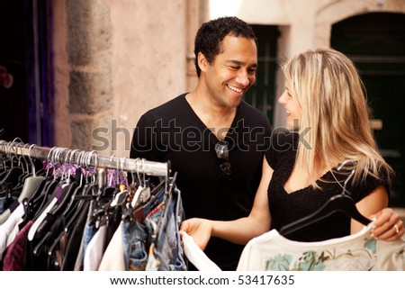 A happy couple shopping at a small street store in Europe