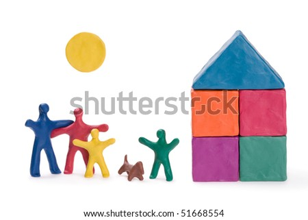 A happy family, a new house and the sun. Abstract.