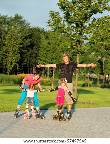 A happy family enjoying weekend in roller skates