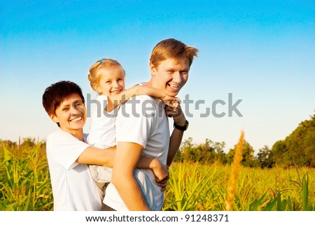 a happy family in a meadow