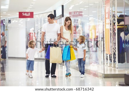 A happy family makes purchases in the store