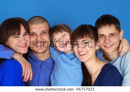 A happy family of five on a blue background