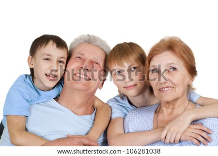 A happy family of four on a light background