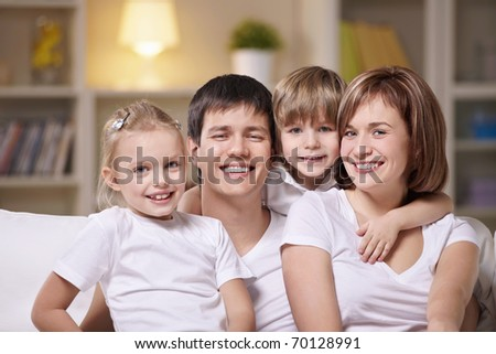 A happy family with children at home in the evening