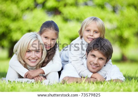 A happy family with children outdoors