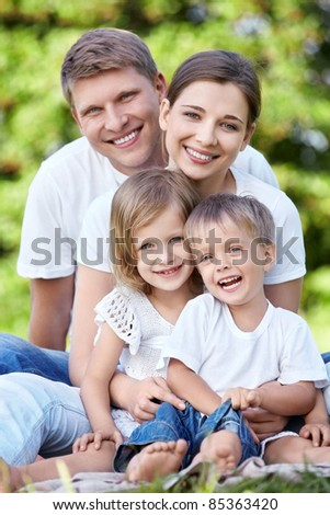 A happy family with kids in the park