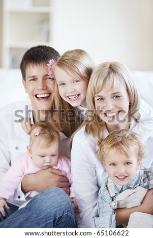 A happy family with kids on the couch at home