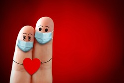 A happy finger couple in love with protective mask Valentines Day during covid 19 coronavirus. New Normal