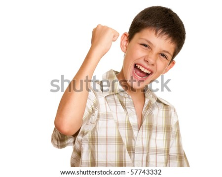 A happy handsome boy is holding his hand symbolizing victory; isolated on the white background