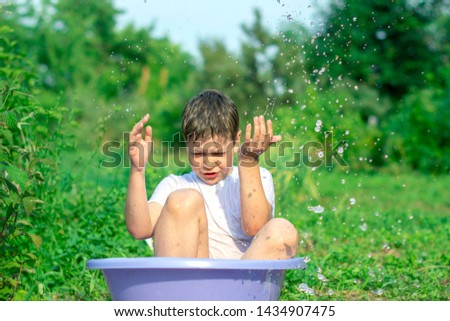 A happy happy happy boy frolicking in the basin. outdoors in summer, spraying water. #1434907475