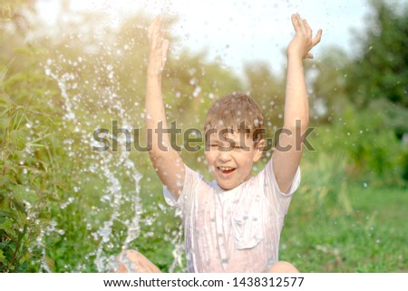 A happy happy happy boy frolicking in the basin. outdoors in summer, spraying water. #1438312577