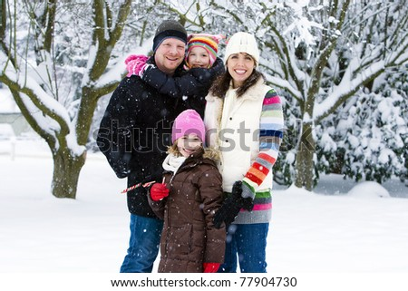 A happy, healthy family outside in the snow.
