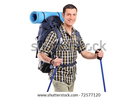 A happy hiker with hiking poles and backpack posing isolated on white background