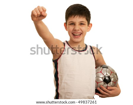 A happy kid is holding his right fist above his head; isolated on the white background