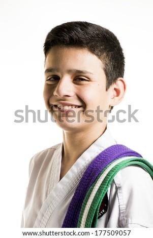 a happy looking boy in his karate uniform.