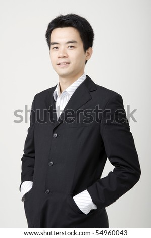 a happy looking young asian business man