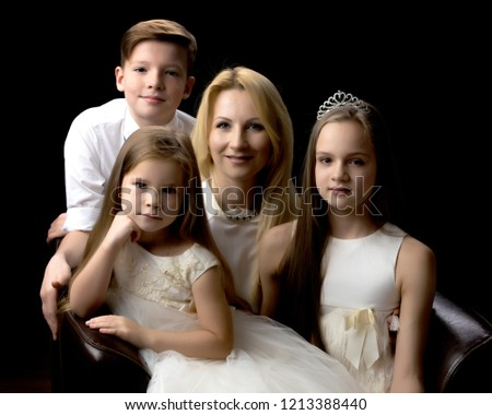 A happy mother with her favorite children. The concept of happy motherhood, childhood, beauty, people, family.