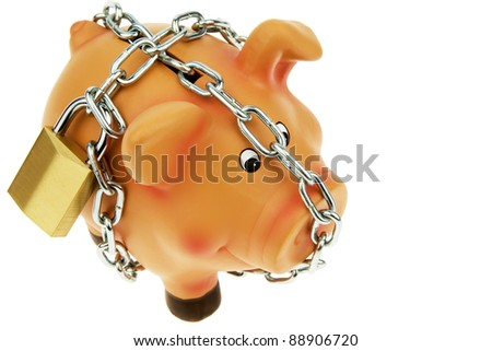 a happy piggy backed with chain and lock. security in saving.