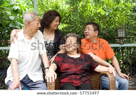 a happy senior couple and their children