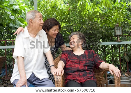 a happy senior couple and their daughter