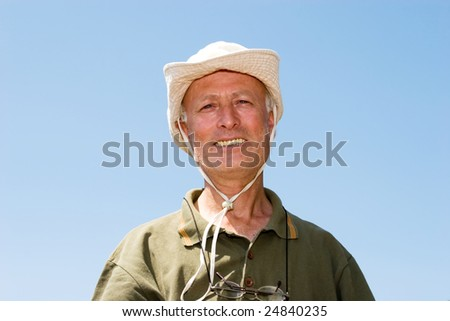 A happy senior farmer man