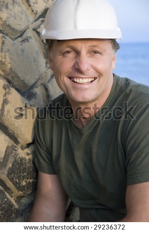 A happy smiling construction worker. - stock photo