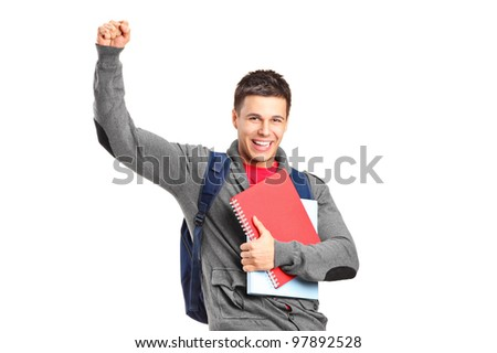 A happy student holding books and gesturing isolated on white background