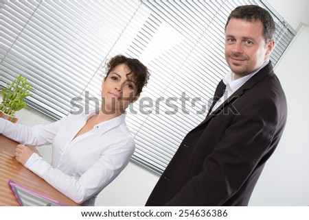 A Happy successful business team or partners with a smiling man and woman