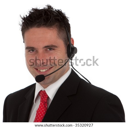 A happy successful businessman wearing a sharp suit and a red tie with a telephony headset on he could also be in custom services isolated on white