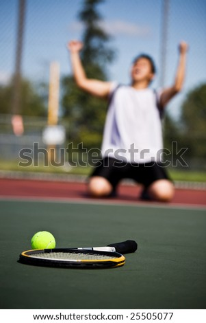A happy tennis player in joy after winning