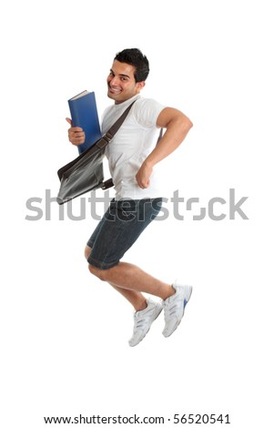 A happy thrilled excited university or college student jumping into the air.  Some motion in legs.  White background.