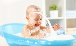 A Happy toddler bathing in bathtub