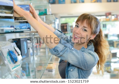 a happy woman arranging the products