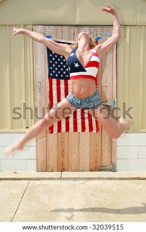 a happy woman jumps for joy because she is free and in america on the forth of july